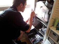 Timothy Dolton Plumber working on boiler